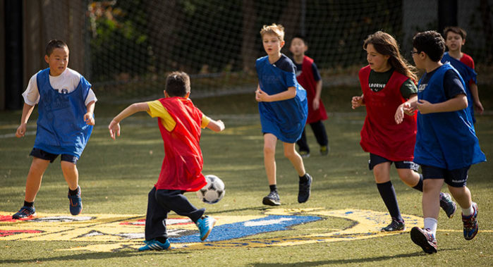 students playing coed soccer