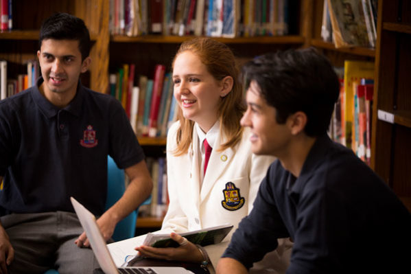 student discussion in library