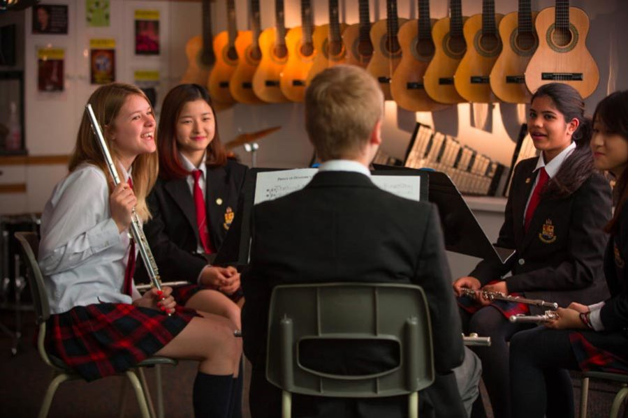 Students in a circle in music room
