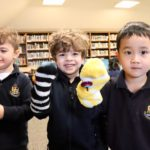 MacLachlan College students with hand puppets